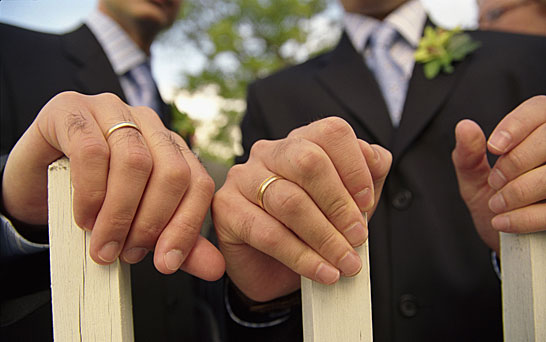 Close up of men's hands at their wedding